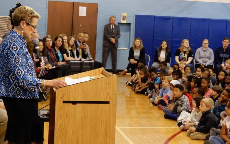 State Superintendent of Schools Dr. Karen B. Salmon speaks to elementary students from a podium in the school gym.