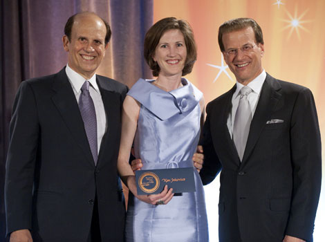 May 15, 2010 Kim Jakovics, a teacher at Annapolis High School, receives $25,000 from Milken Family Foundation Co-Founder Michael Milken (left) and Foundation Chairman Lowell Milken (right) at the 2010 Milken Family Foundation National Educator Forum in Los Angeles, CA on May 15, 2010.